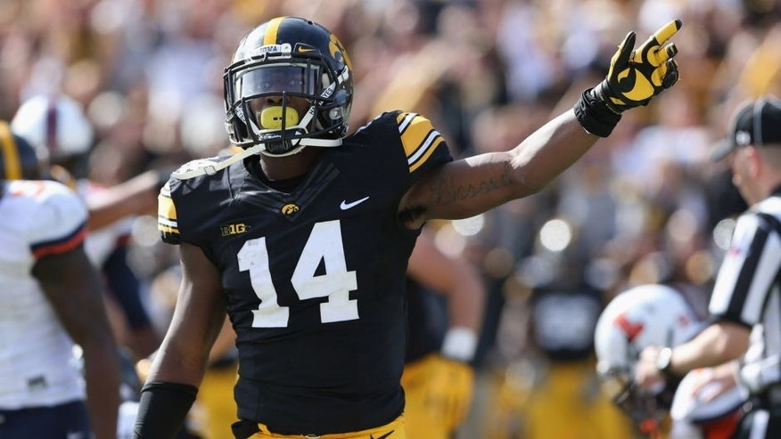 Oct 10, 2015; Iowa City, IA, USA; Iowa Hawkeyes defensive back Desmond King (14) signals for the first down late in the fourth quarter after Iowa recovered a fumble against the Illinois Fighting Illini at Kinnick Stadium. Iowa beat Illinois 29-20. Mandatory Credit: Reese Strickland-USA TODAY Sports