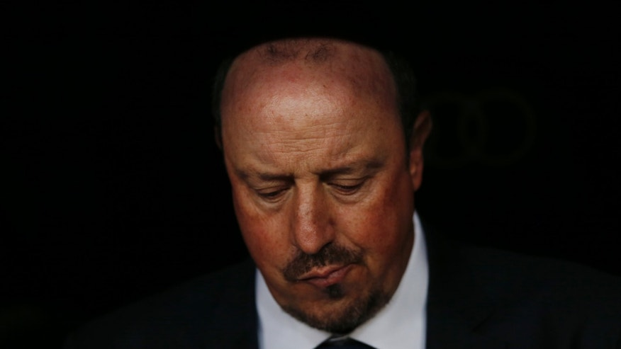 FILE - In this Nov. 21, 2015 file photo, Real Madrid's head coach Rafael Benitez sits on the bench before the first clasico of the season between Real Madrid and Barcelona at the Santiago Bernabeu stadium in Madrid, Spain. Real Madridâs President Florentino Perez announced Monday Jan. 4, 2016 that current coach Rafael Benitez has been fired and former player and Real Madridâs B team coach Zinedine Zidane will take over. Benitez, hired seven months ago, has been under pressure since a demoralising 4-0 home loss to Barcelona in November. The team won seven of nine matches since the defeat at the Bernabeu, but fans continued to call for Benitez's departure. (AP Photo/Daniel Ochoa de Olza, File)
