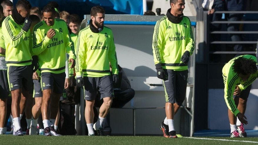 Real Madrid's Cristiano Ronaldo, right, walks onto the pitch with some of his team mates during a training session, the first under newly appointed coach Zinedine Zidane in Madrid, Spain, Tuesday Jan. 5, 2016. Real Madrid fired coach Rafael Benitez Monday after seven months and replaced him with former player Zinedine Zidane a day after Madrid's 2-2 draw at Valencia deepened a crisis that started with an embarrassing 4-0 home loss to rival Barcelona in November. (AP Photo/Paul White)
