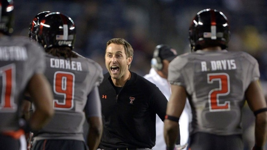 Dec 30, 2013; San Diego, CA, USA; Texas Tech Red Raiders coach Kliff Kingsbury celebrates after a touchdown against the Arizona State Sun Devils during the 2013 Holiday Bowl at Qualcomm Stadium. Mandatory Credit: Kirby Lee-USA TODAY Sports