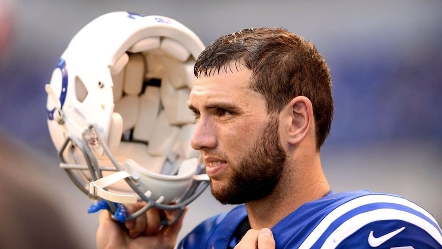 Sep 28, 2014; Indianapolis, IN, USA; Indianapolis Colts quarterback Andrew Luck (12) on the sidelines during the fourth quarter against the Tennessee Titans at Lucas Oil Stadium. Colts defeated the Titans 41-17. Mandatory Credit: Andrew Weber-USA TODAY Sports