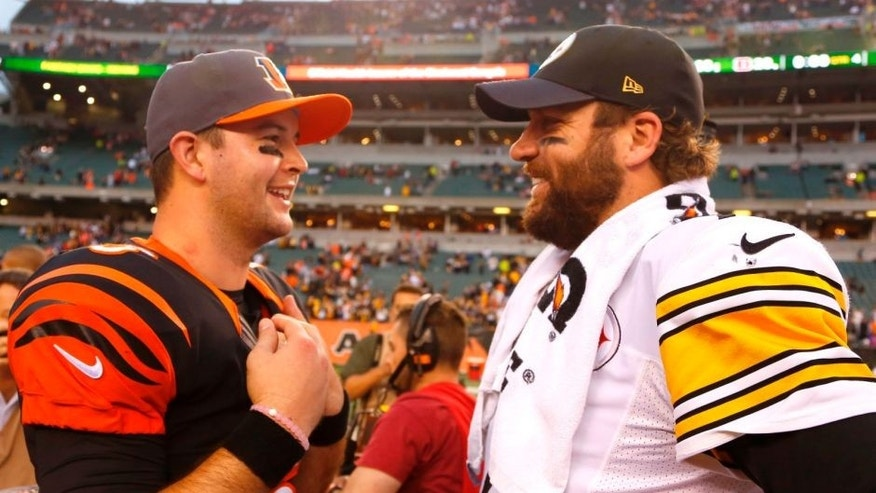 Dec 13, 2015; Cincinnati, OH, USA; Pittsburgh Steelers quarterback Ben Roethlisberger (R) talks with Cincinnati Bengals quarterback AJ McCarron (L) after the Steelers beat the Bengals 33-20 at Paul Brown Stadium. Mandatory Credit: David Kohl-USA TODAY Sports