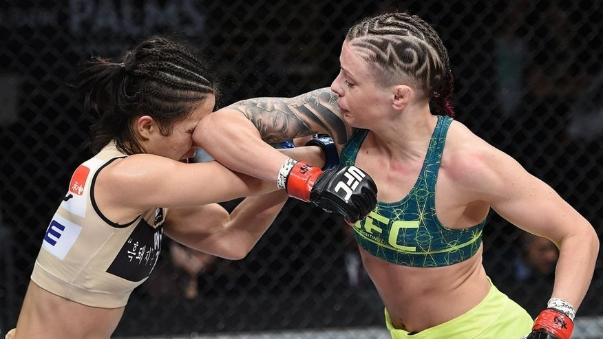 LAS VEGAS, NEVADA - DECEMBER 12: (R-L) Joanne Calderwood elbows Seohee Ham in their strawweight fight during The Ultimate Fighter Finale event inside the Palms Casino Resort on December 12, 2014 in Las Vegas, Nevada. (Photo by Jeff Bottari/Zuffa LLC/Zuffa LLC via Getty Images)