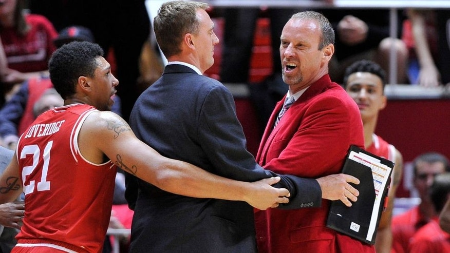SALT LAKE CITY, UT - DECEMBER 2: Jordan Loveridge #21, assistant coach Phil Cullen of the Utah Utes, restrain head coach Larry Krystkowiak of the Utah Utes after an on court incident against the Brigham Young Cougars at the Jon M. Huntsman Center on December 2, 2015 in Salt Lake City, Utah. (Photo by Gene Sweeney Jr/Getty Images)