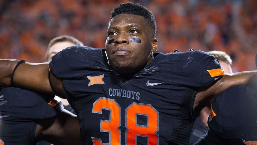 Nov 7, 2015; Stillwater, OK, USA; Oklahoma State Cowboys defensive end Emmanuel Ogbah (38) after the game against the TCU Horned Frogs at Boone Pickens Stadium. OSU won 49-29. Mandatory Credit: Rob Ferguson-USA TODAY Sports
