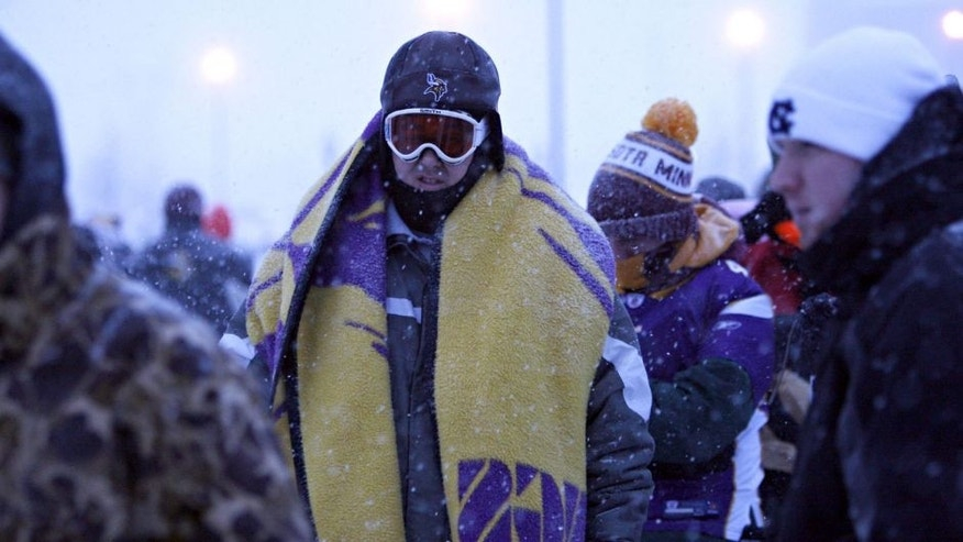 Snow continues to fall, as fans arrive at TCF Bank Stadium for the Minnesota Vikings' game against the Chicago Bears in Minneapolis, Minnesota, Monday, December 20, 2010. (Brian Cassella/Chicago Tribune/MCT via Getty Images)