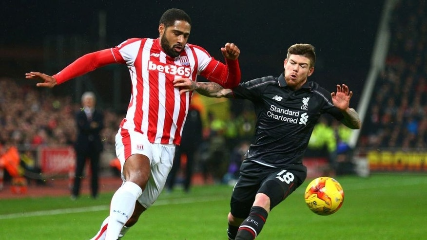 STOKE ON TRENT, ENGLAND - JANUARY 05: Glen Johnson of Stoke City and Alberto Moreno of Liverpool battle for the ball during the Capital One Cup semi final, first leg match between Stoke City and Liverpool at the Britannia Stadium on January 5, 2016 in Stoke on Trent, England. (Photo by Clive Mason/Getty Images)