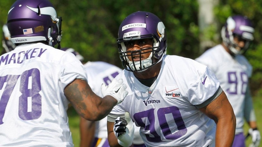 <p>Minnesota Vikings defensive end B.J. Dubose (90) participates in a drill during NFL football rookie minicamp Friday, May 8, 2015, in Eden Prairie, Minn. The Vikings signed all 10 rookies from the class of 2015 to contracts before the first minicamp opened on Friday. (AP Photo/Ann Heisenfelt)</p>