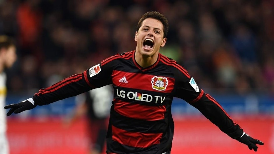 Leverkusen's Mexican striker Javier Hernandez celebrates after scoring during the German first division Bundesliga football match Bayer 04 Leverkusen vs Borussia Moenchengladbach in Leverkusen, western Germany, on December 12, 2015. AFP PHOTO / PATRIK STOLLARZ RESTRICTIONS: DURING MATCH TIME: DFL RULES TO LIMIT THE ONLINE USAGE TO 15 PICTURES PER MATCH AND FORBID IMAGE SEQUENCES TO SIMULATE VIDEO. == RESTRICTED TO EDITORIAL USE == FOR FURTHER QUERIES PLEASE CONTACT DFL DIRECTLY AT + 49 69 650050. / AFP / PATRIK STOLLARZ (Photo credit should read PATRIK STOLLARZ/AFP/Getty Images)