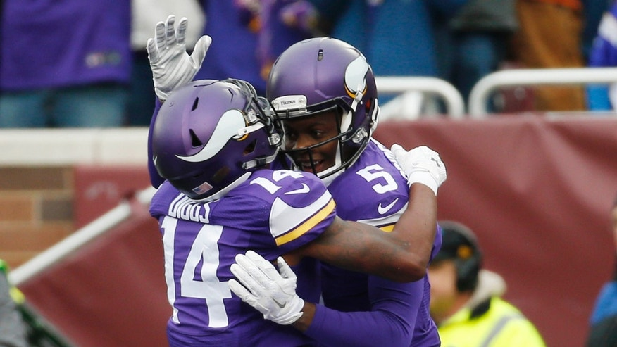 Dec. 20, 2015: Minnesota Vikings quarterback Teddy Bridgewater (5) celebrates a touchdown by wide receiver Stefon Diggs (14) during the first half of an NFL football game against the Chicago Bears, in Minneapolis.
