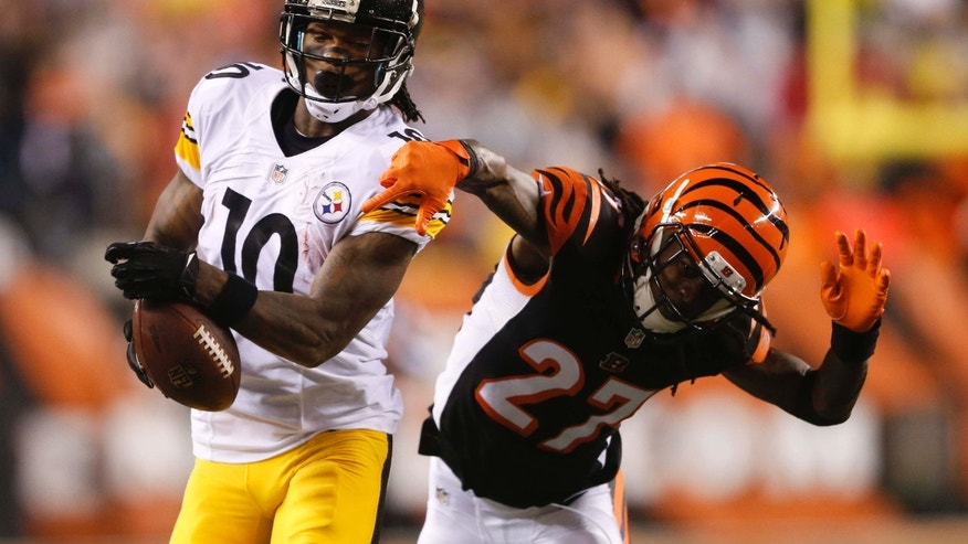 Pittsburgh Steelers wide receiver Martavis Bryant (10) is tackled by Cincinnati Bengals' Dre Kirkpatrick (27) during the second half of an NFL wild-card playoff football game Saturday, Jan. 9, 2016, in Cincinnati.