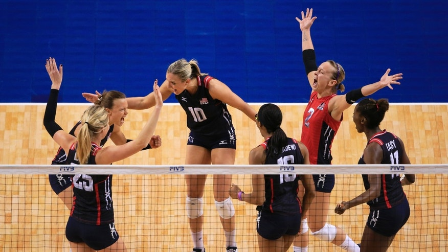 United States' Courtney Thompson, back left, Jordan Larson-Burbach (10), Kayla Banwarth (2) and others celebrate a point against the Dominican Republic in a women's volleyball NORCECA round-robin Olympic qualifying tournament match in Lincoln, Neb., Saturday, Jan. 9, 2016. (AP Photo/Nati Harnik)
