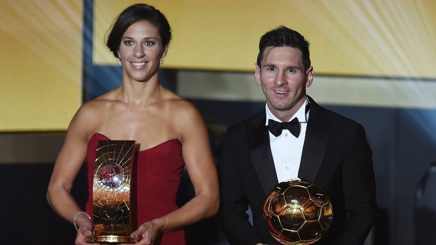 Carli Lloyd of the USA and Argentina's Lionel Messi pose with their trophies after winning the FIFA soccer player of the year 2015 prize during the FIFA Ballon d'Or awarding ceremony at the Kongresshaus in Zurich, Switzerland, Monday, January 11, 2016. (Valeriano Di Domenico/KEYSTONE via AP))