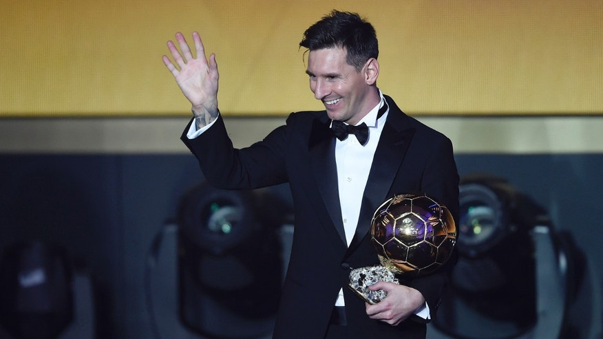 Argentina's Lionel Messi poses with his trophy after winning the FIFA Men's soccer player of the year 2015 prize during the FIFA Ballon d'Or awarding ceremony at the Kongresshaus in Zurich, Switzerland, Monday, January 11, 2016. (Valeriano Di Domenico/KEYSTONE via AP))