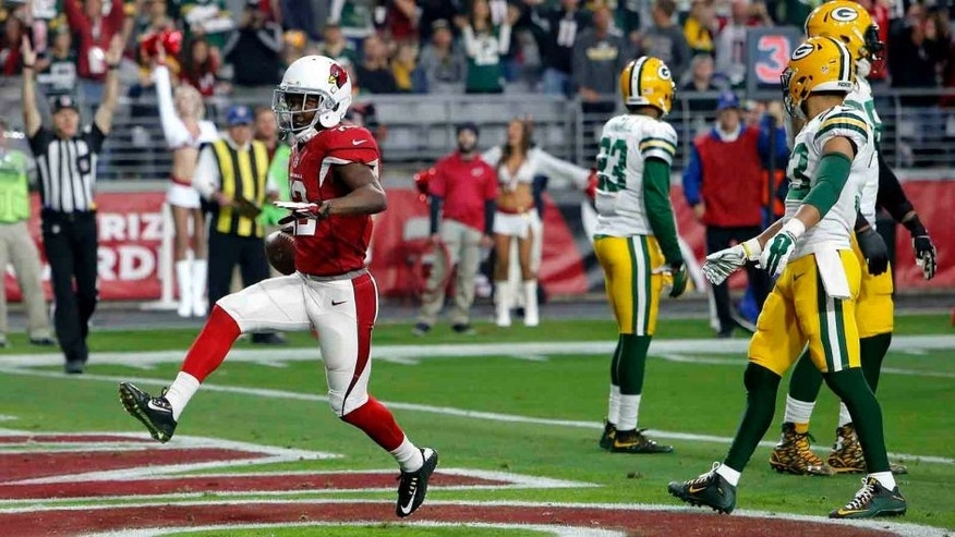 Arizona Cardinals wide receiver John Brown scores a touchdown against the Green Bay Packers during the first half Sunday, Dec. 27, 2015, in Glendale, Ariz.