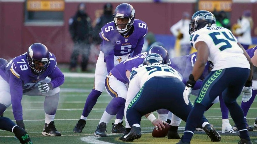 Minnesota Vikings quarterback Teddy Bridgewater calls a play during the first half against the Seattle Seahawks on Sunday, Jan. 10, 2016, in Minneapolis.
