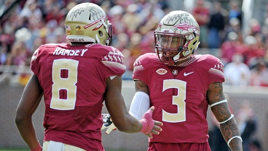 Nov 14, 2015; Tallahassee, FL, USA; Florida State University defensive back Jalen Ramsey (8) celebrates with defensive back Derwin James (3) after a defensive stop during the game against the North Carolina State Wolfpack at Doak Campbell Stadium. Mandatory Credit: Melina Vastola-USA TODAY Sports