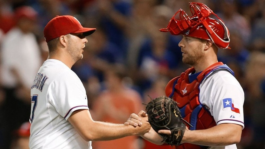 <p>Aug 28, 2015; Arlington, TX, USA; Texas Rangers relief pitcher Shawn Tolleson (37) is congratulated by catcher Chris Gimenez (38) after the game against the Baltimore Orioles at Globe Life Park in Arlington. Texas won 4-1. Mandatory Credit: Tim Heitman-USA TODAY Sports</p>