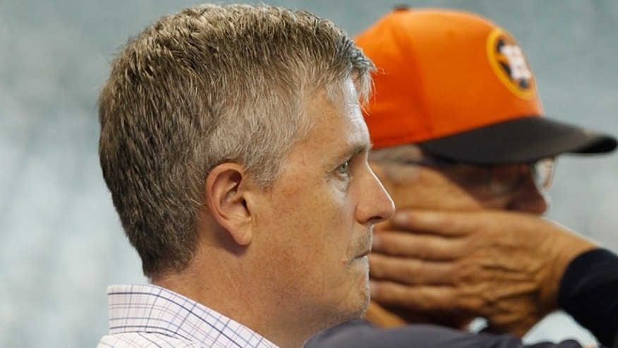 Houston Astros general manager Jeff Luhnow, who was raised in Mexico City, looks on during batting practice before a game between the Los Angeles Angels of Anaheim and Houston Astros at Minute Maid Park on September 3, 2014 in Houston, Texas.  (Photo by Bob Levey/Getty Images)