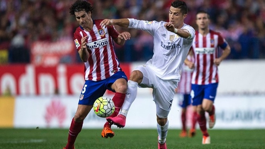 MADRID, SPAIN - OCTOBER 04: Cristiano Ronaldo (R) of Real Madrid CF competes for the ball with Tiago Mendes (L) of Atletico de Madrid during the La Liga match between Club Atletico de Madrid and Real Madrid CF at Vicente Calderon Stadium on October 4, 2015 in Madrid, Spain.  (Photo by Gonzalo Arroyo Moreno/Getty Images)