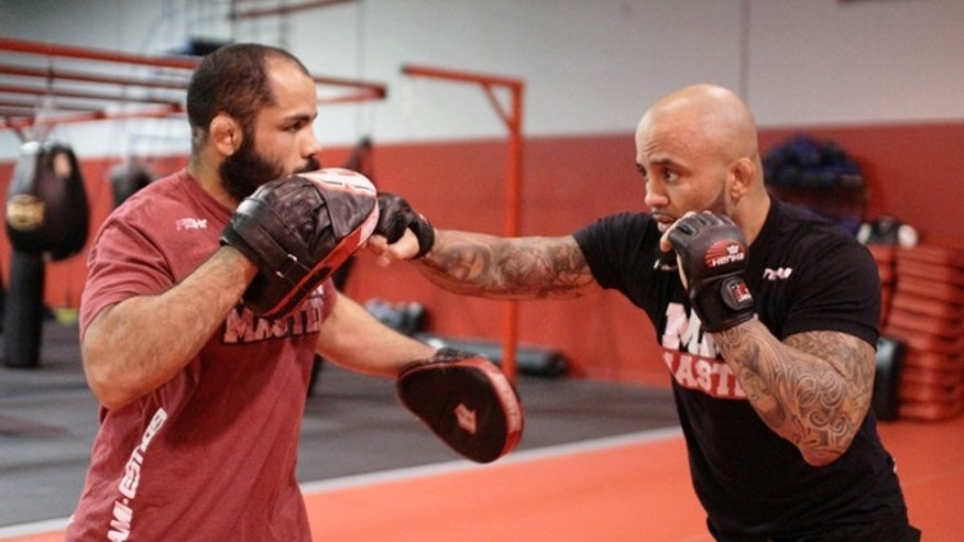 """Rene """"Level"""" Martinez (left) trains with fellow MMA Masters teammate Frank Carrillo in Miami. Martinez is soon to release a documentary based on his trials and tribulations leading to his career as a professional mixed martial artist. (Rodolfo Roman/Fox News Latino)"""