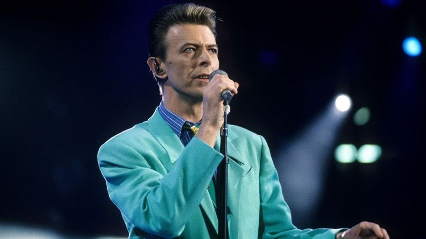 "David Bowie performs ""Under Pressure"" (Photo by Kevin Mazur Archive/WireImage)"