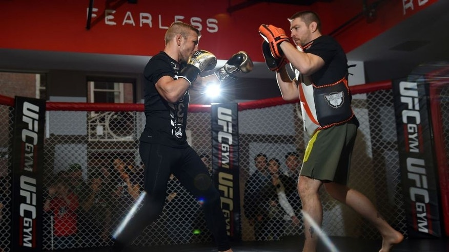 BOSTON, MA - JANUARY 15: UFC bantamweight champion TJ Dillashaw (L) works out with his coach Duane Ludwig (R) for fans and media at the UFC Gym on January 15, 2016 in Boston, Massachusetts. (Photo by Jeff Bottari/Zuffa LLC/Zuffa LLC via Getty Images)
