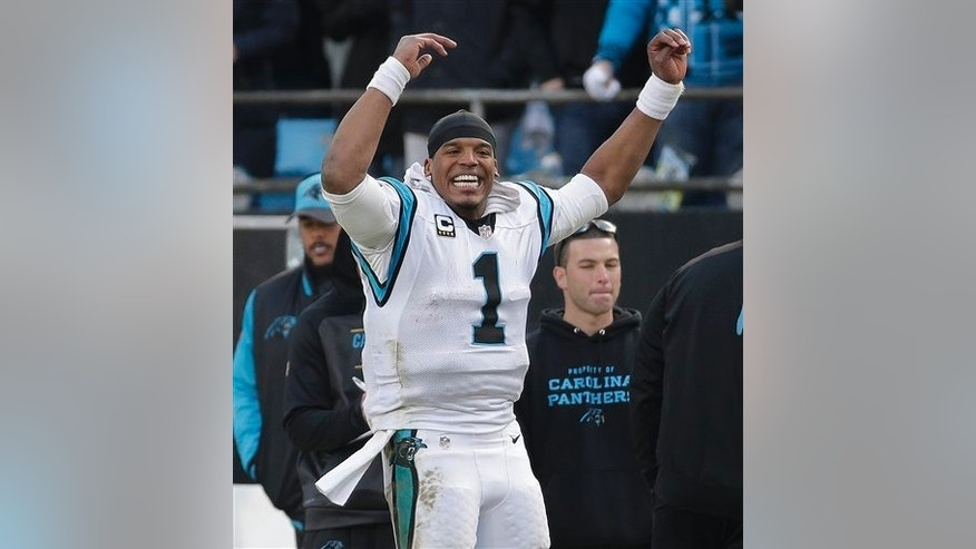 Carolina Panthers quarterback Cam Newton (1) cheers on the sidelines during the second half of an NFL divisional playoff football game against the Seattle Seahawks, Sunday, Jan. 17, 2016, in Charlotte, N.C. The Carolina Panthers won 31-24.(AP Photo/Chuck Burton)