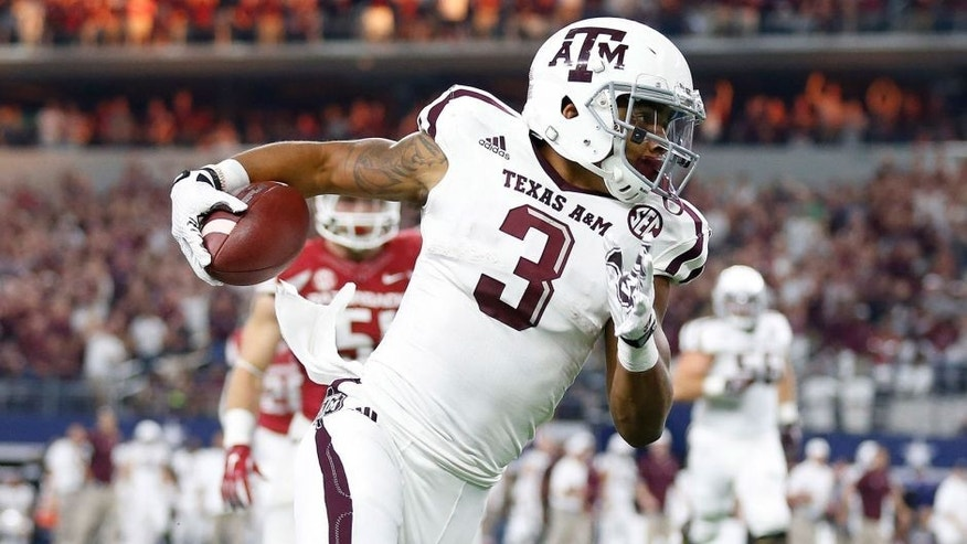 Sep 26, 2015; Arlington, TX, USA; Texas A&M Aggies receiver Christian Kirk (3) runs after a reception in the second quarter against the Arkansas Razorbacks at AT&T Stadium. Mandatory Credit: Matthew Emmons-USA TODAY Sports