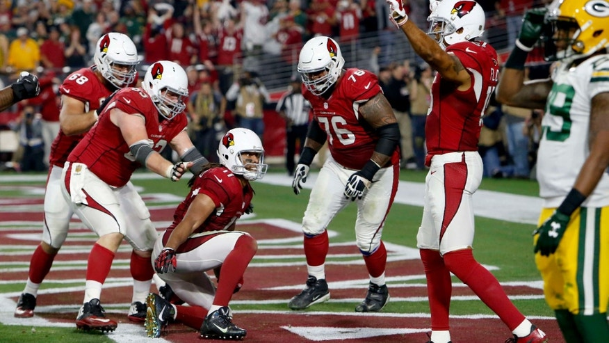 Jan. 16, 2016: Arizona Cardinals wide receiver Larry Fitzgerald (11) celebrates his game winning touchdown with teammates agasint the Green Bay Packers during overtime of an NFL divisional playoff football game.