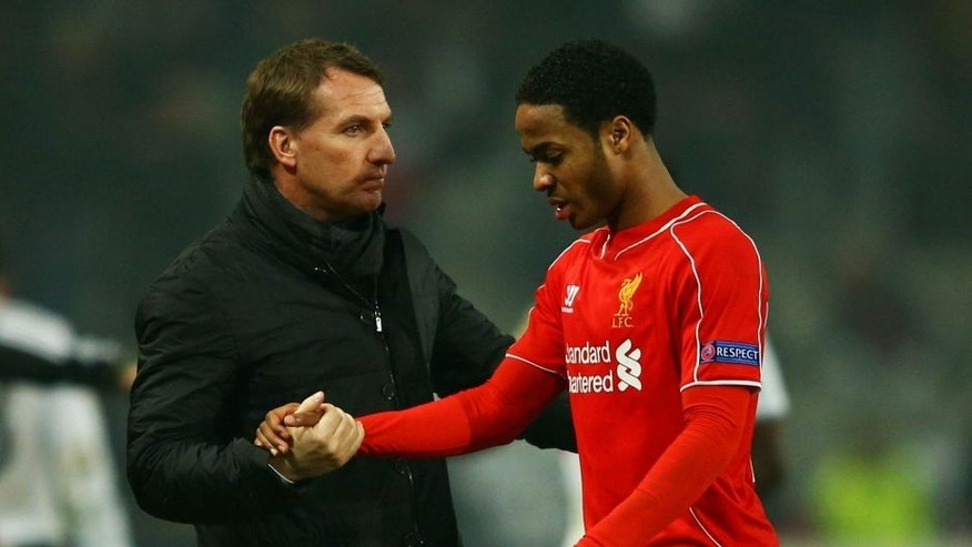 ISTANBUL, TURKEY - FEBRUARY 26: Brendan Rodgers manager of Liverpool shakes hands with Raheem Sterling of Liverpool after defeat in a penalty shoot out during the UEFA Europa League Round of 32 second leg match between Besiktas JK and Liverpool FC on February 26, 2015 in Istanbul, Turkey. (Photo by Richard Heathcote/Getty Images)