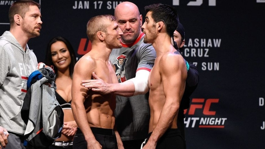 BOSTON, MA - JANUARY 16: (L-R) Opponents TJ Dillashaw and Dominick Cruz face off during the UFC weigh-in at the Wang Theatre on January 16, 2016 in Boston, Massachusetts. (Photo by Jeff Bottari/Zuffa LLC/Zuffa LLC via Getty Images)