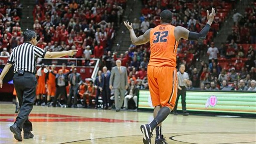 The referee calls a foul against Oregon State forward Jarmal Reid (32) after he is tripped by Reid during the second half of an NCAA college basketball game Sunday, Jan. 17, 2016, in Salt Lake City. Reid was ejected from the game. Utah won 59-53. (AP Photo/Rick Bowmer)