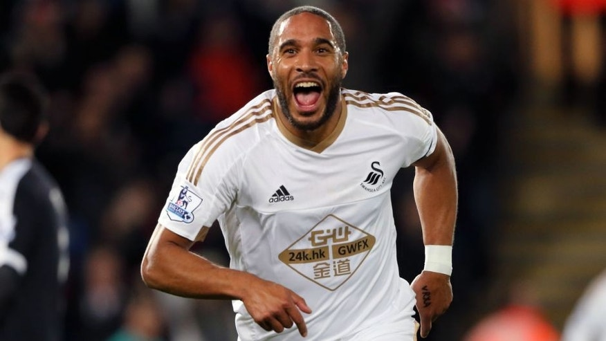 SWANSEA, WALES - JANUARY 18: Ashley Williams of Swansea City celebrates after scoring a goal to make it 1-0 during the Barclays Premier League match between Swansea City and Watford at the Liberty Stadium on January 18, 2016 in Swansea, Wales. (Photo by Matthew Ashton - AMA/Sports Photo Agency)