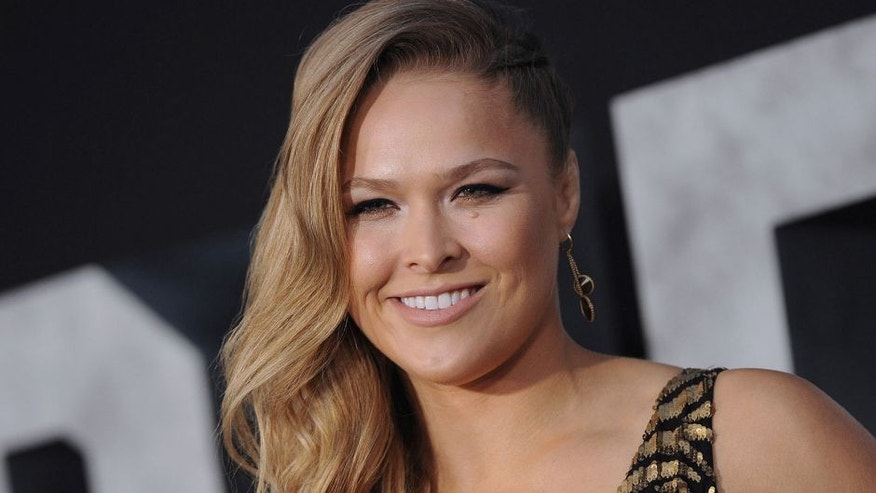 HOLLYWOOD, CA - AUGUST 11: Actress/MMA fighter Ronda Rousey arrives at the Los Angeles premiere of 'The Expendables 3' at TCL Chinese Theatre on August 11, 2014 in Hollywood, California. (Photo by Axelle/Bauer-Griffin/FilmMagic)