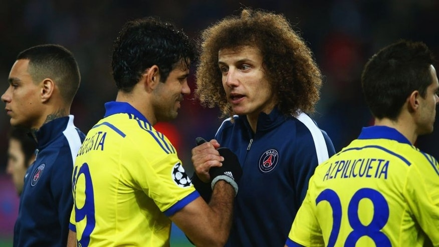 PARIS, FRANCE - FEBRUARY 17: Diego Costa of Chelsea and David Luiz of Paris Saint-Germain shake hands prior to during the UEFA Champions League Round of 16 match between Paris Saint-Germain and Chelsea at Parc des Princes on February 17, 2015 in Paris, France. (Photo by Clive Rose/Getty Images)