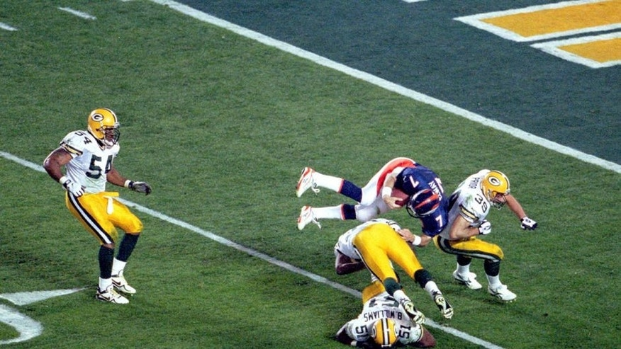 Denver quarterback John Elway goes airborne to pick up a first down in Super Bowl XXXII at Qualcomm Stadium in San Diego, CA. The Broncos defeated the Green Bay Packers 31-24 on 1/25/1998. (Photo by Kevin Reece/Getty Images)
