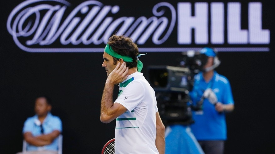 Jan. 18, 2016: Roger Federer of Switzerland walks to the back of the court during his first round match against Nikoloz Basilashvili of Georgia at the Australian Open tennis championships in Melbourne, Australia.