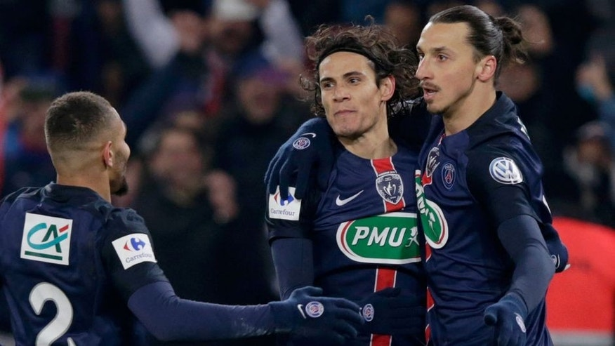 Paris Saint-Germain's Swedish forward Zlatan Ibrahimovic (R) celebrates with Paris Saint-Germain's Uruguayan forward Edinson Cavani (C) after scoring a goal during the French Cup football match between Paris Saint-Germain (PSG) and Toulouse (TFC) on January 19, 2015 at the Parc des Princes stadium, in Paris. AFP PHOTO / KENZO TRIBOUILLARD / AFP / KENZO TRIBOUILLARD (Photo credit should read KENZO TRIBOUILLARD/AFP/Getty Images)