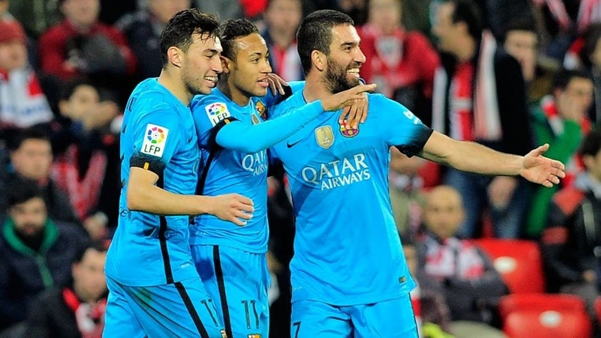 Barcelona's Brazilian forward Neymar da Silva Santos Junior (C) celebrates a goal with forward Munir El Haddadi (L) and Turkish midfielder Arda Turan during the Spanish Copa del Rey (King's Cup) football match Athletic Club de Bilbao vs FC Barcelona at the San Mames stadium in Bilbao on January 20, 2016. AFP PHOTO / ANDER GILLENEA / AFP / ANDER GILLENEA (Photo credit should read ANDER GILLENEA/AFP/Getty Images)