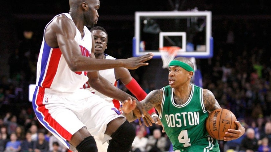 Apr 8, 2015; Auburn Hills, MI, USA; Boston Celtics guard Isaiah Thomas (4) dribbles the ball as Detroit Pistons center Joel Anthony (50) and guard Reggie Jackson (1) defend during the second quarter at The Palace of Auburn Hills. The Celtics won 113-103. Mandatory Credit: Raj Mehta-USA TODAY Sports