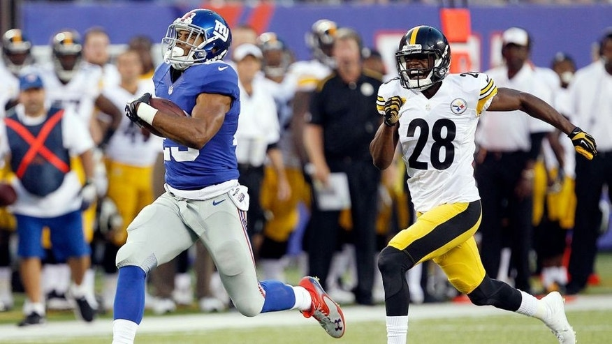 Aug 9, 2014; East Rutherford, USA; New York Giants running back Rashad Jennings (23) scores a touchdown past Pittsburgh Steelers cornerback Cortez Allen (28) during the preseason game at MetLife Stadium. Mandatory Credit: William Perlman/THE STAR-LEDGER via USA TODAY Sports