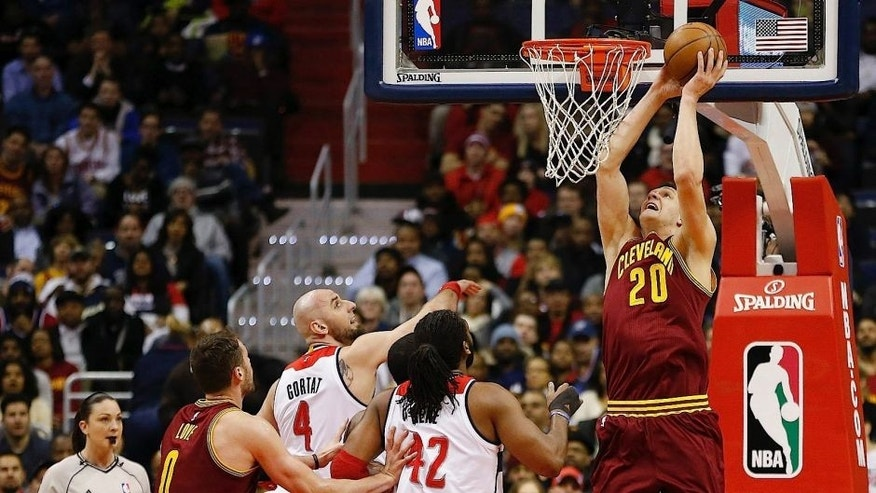 <p>Cleveland Cavaliers center Timofey Mozgov (20) dunks the ball as Washington Wizards forward Nene (42) and Wizards center Marcin Gortat (4) look on in the first quarter at Verizon Center.</p>