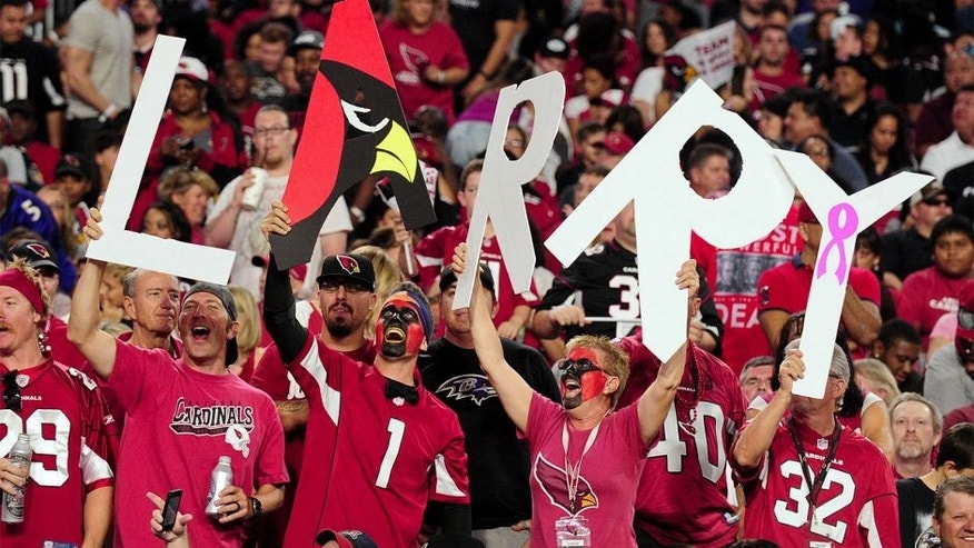 Oct 26, 2015; Glendale, AZ, USA; Arizona Cardinals fans cheers during the second half against the Baltimore Ravens at University of Phoenix Stadium. Mandatory Credit: Matt Kartozian-USA TODAY Sports