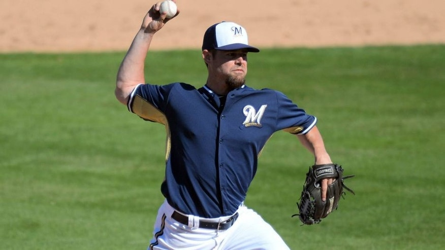 <p>Mar 5, 2014; Phoenix, AZ, USA; Milwaukee Brewers relief pitcher Rob Wooten (47) pitches during the sixth inning against the Oakland Athletics at Maryvale Baseball Park.  </p>
