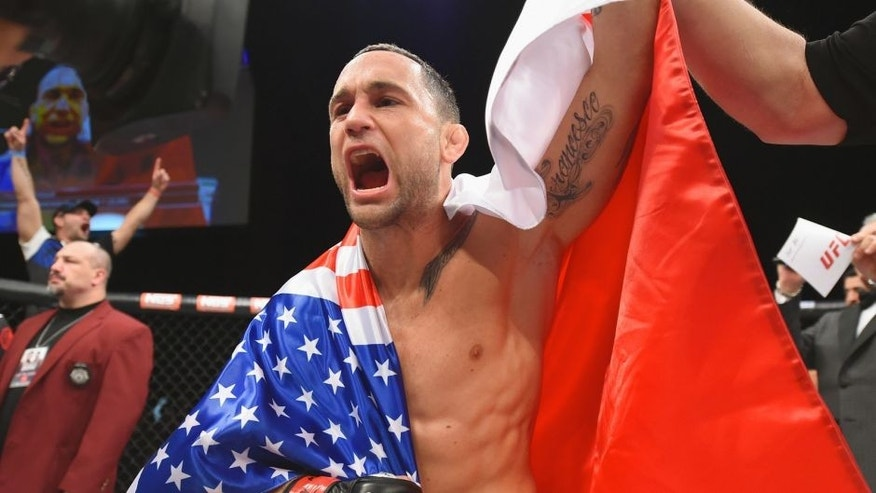 Frankie Edgar reacts to his victory over Chad Mendes in their featherweight bout during the TUF Finale event inside The Chelsea at The Cosmopolitan of Las Vegas on December 11, 2015 in Las Vegas, Nevada. (Photo by Jeff Bottari/Zuffa LLC/Zuffa LLC via Getty Images)