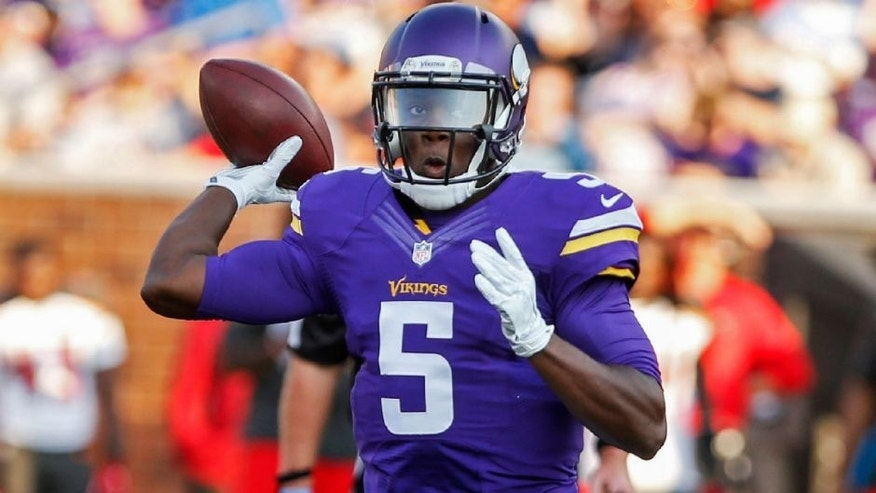 <p>Aug 15, 2015; Minneapolis, MN, USA; Minnesota Vikings quarterback Teddy Bridgewater (5) passes against the Tampa Bay Buccaneers in the first quarter in a preseason NFL football game at TCF Bank Stadium. Mandatory Credit: Bruce Kluckhohn-USA TODAY Sports</p>