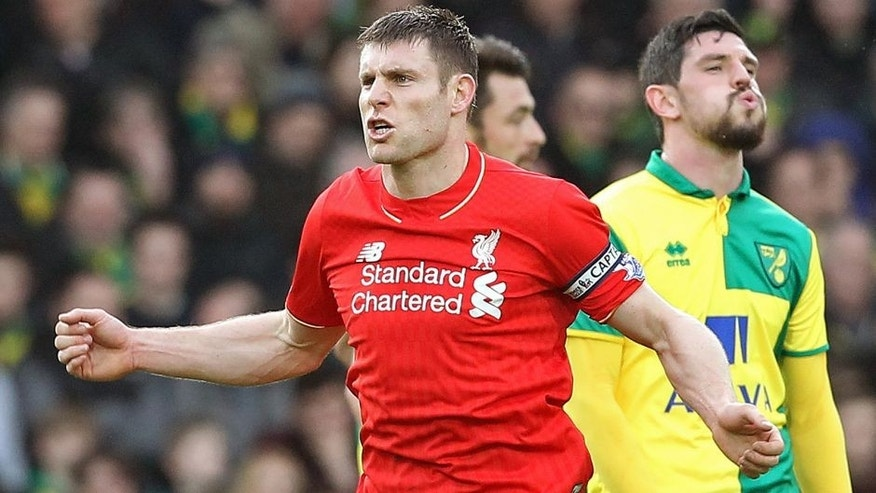 LiverpoolÕs captain English midfielder James Milner celebrates scoring their fourth goal during the English Premier League football match between Norwich City and Liverpool at Carrow Road in Norwich, eastern England, on January 23, 2016. AFP PHOTO / LINDSEY PARNABY RESTRICTED TO EDITORIAL USE. No use with unauthorized audio, video, data, fixture lists, club/league logos or 'live' services. Online in-match use limited to 75 images, no video emulation. No use in betting, games or single club/league/player publications. / AFP / LINDSEY PARNABY (Photo credit should read LINDSEY PARNABY/AFP/Getty Images)