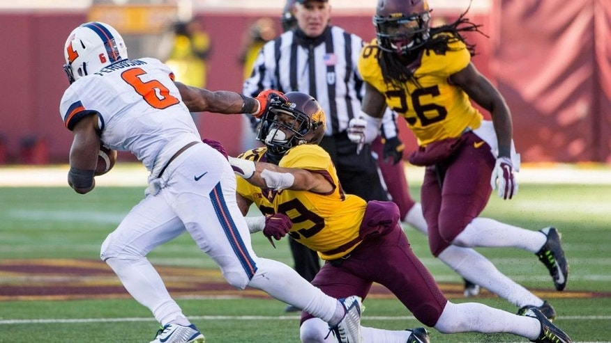 Nov 21, 2015; Minneapolis, MN, USA; Minnesota Golden Gophers defensive back Briean Boddy-Calhoun (29) gets stiff armed by Illinois Fighting Illini running back Josh Ferguson (6) in the second half at TCF Bank Stadium. The Gophers won 32-23. Mandatory Credit: Jesse Johnson-USA TODAY Sports