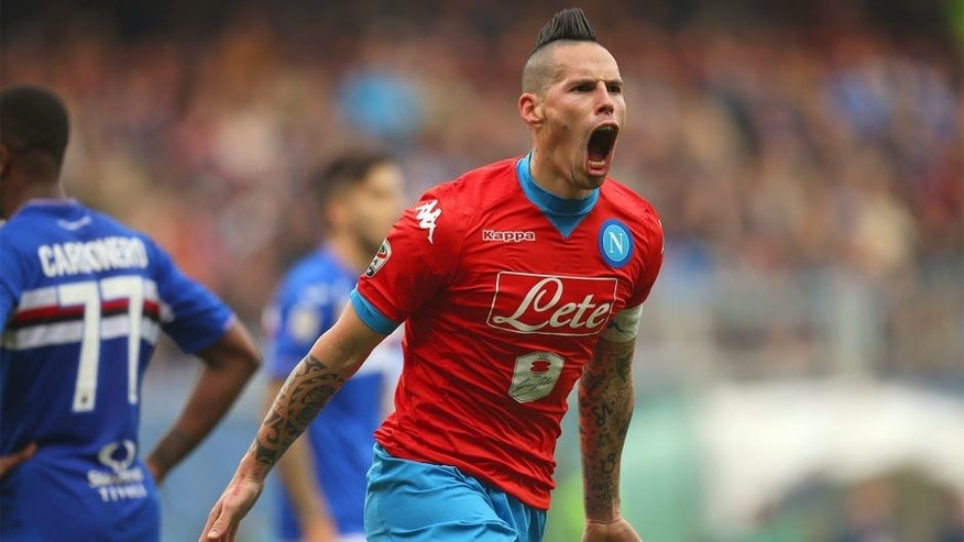 Napoli's midfielder Marek Hamsik from Slovakia celebrates after scoring during the Italian Serie A football match Sampdoria Vs Napoli on January 24, 2016 at 'Luigi Ferraris Stadium' in Genoa. AFP PHOTO / MARCO BERTORELLO / AFP / MARCO BERTORELLO (Photo credit should read MARCO BERTORELLO/AFP/Getty Images)